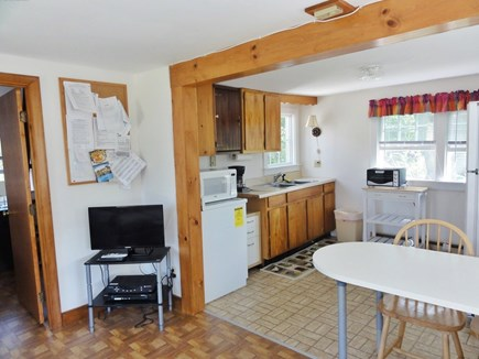 Wellfleet Cape Cod vacation rental - Bedroom to left and kitchen area from living area