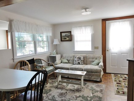 Wellfleet Cape Cod vacation rental - Living area with front door to right - from kitchen