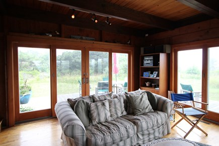 Truro Cape Cod vacation rental - Living room looking to the outside table and lawn