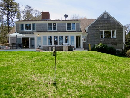 Orleans Cape Cod vacation rental - Backside of the house where you will find a deck and brick patio.