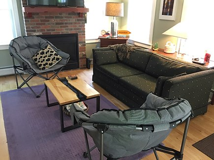 Provincetown Cape Cod vacation rental - Living room with TV and fireplace
