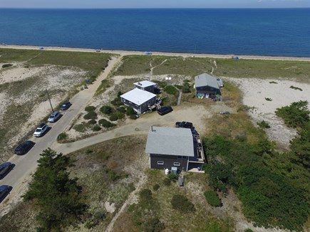 Truro Cape Cod vacation rental - Aerial view of cottage (white roof) and beach in August