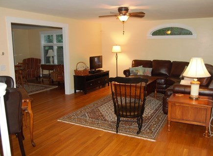 North Eastham Cape Cod vacation rental - Living room with leather sofa and smart TV