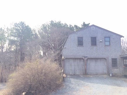 Eastham, Aerie, a 2nd story suite Cape Cod vacation rental - Garage w/front entry on left. Looks great in summer!!