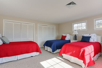 Chatham Cape Cod vacation rental - Upper level guest bedroom has four twin beds.