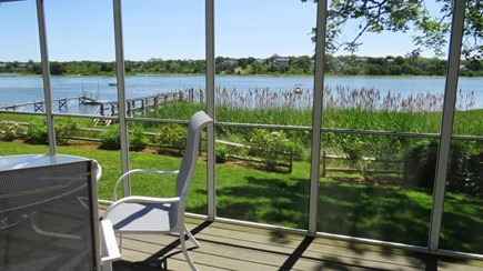 Eastham Cape Cod vacation rental - Screened porch with view of the dock and water