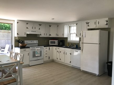 Eastham near the bayside Cape Cod vacation rental - Full, open, eat-in Kitchen with access to the deck