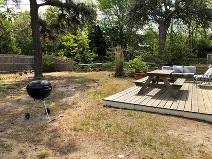 Wellfleet Cape Cod vacation rental - Backyard - deck with picnic table and grill (charcoal & gas)