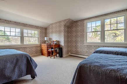 Orleans Cape Cod vacation rental - West-facing upstairs bedroom with full size bed and two twins, AC