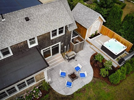 West Falmouth Cape Cod vacation rental - Backyard with Hot Tub, Fire place, bbq, and outdoor shower