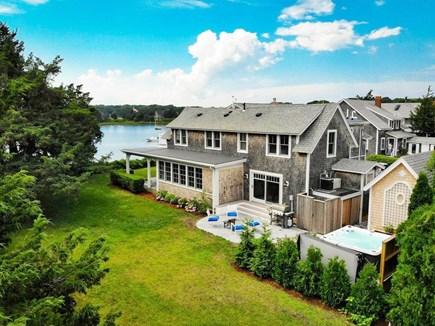 West Falmouth Cape Cod vacation rental - Harbor House from the backyard toward Snug Harbor