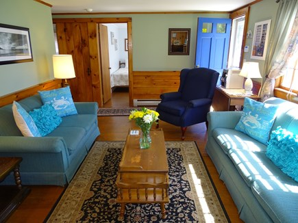 Dennis Cape Cod vacation rental - Sunny living room, showing entrance to bedrooms