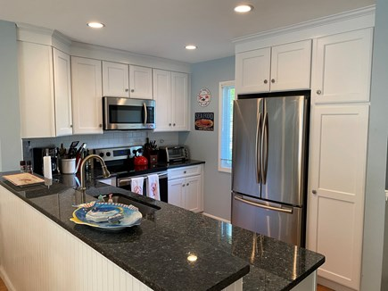 Brewster Cape Cod vacation rental - Blue Pearl Granite and Stainless Steel appliances in the kitchen