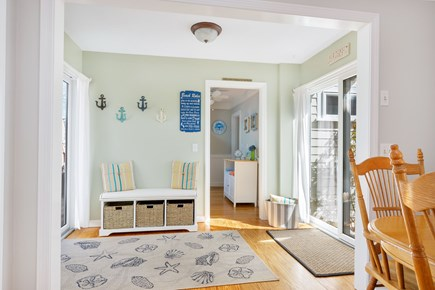 West Dennis Cape Cod vacation rental - Front to back entry way with wall hooks and storage bench