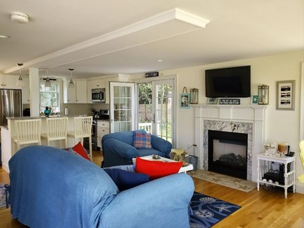 West Dennis Cape Cod vacation rental - Open floor with gas fireplace and Central a/c