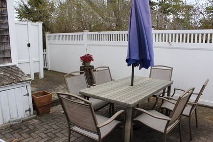 Dennis Port Cape Cod vacation rental - Private patio area with table, chairs, umbrella, and grill.