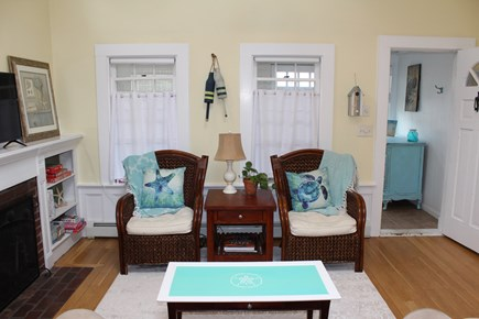 Dennis Port Cape Cod vacation rental - Living room with a cathedral ceiling, sofa, and two chairs.