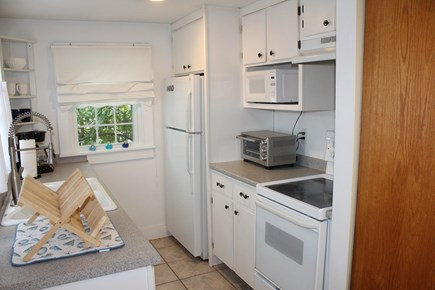 Dennis Port Cape Cod vacation rental - Galley kitchen that includes microwave and toaster oven.