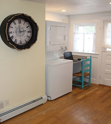 Dennis Port Cape Cod vacation rental - Stacked washer/dryer and study area.