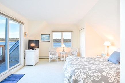 East Harwich Cape Cod vacation rental - Upstairs bedroom with deck access, ocean view and queen bed