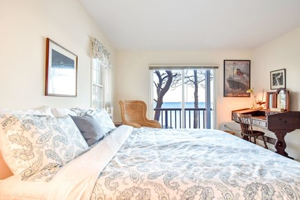 East Harwich Cape Cod vacation rental - Downstairs bedroom with king bed with slider door to deck