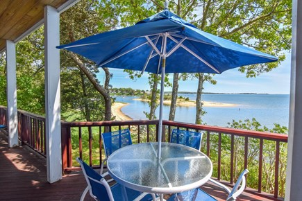 East Harwich Cape Cod vacation rental - Sitting area on deck with views of Pleasant Bay