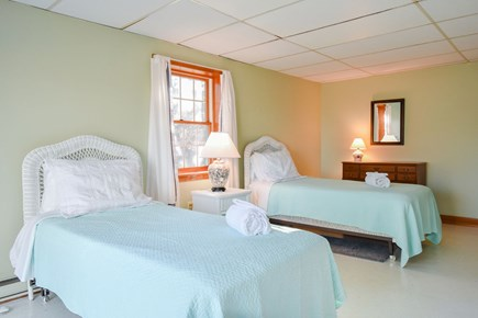 East Harwich Cape Cod vacation rental - Lower bedroom with 2 twin beds and slider door leading outside