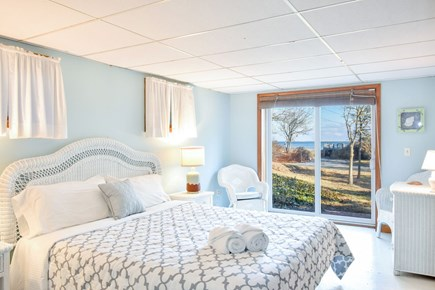 East Harwich Cape Cod vacation rental - Master bedroom with slider door leading outside with water views