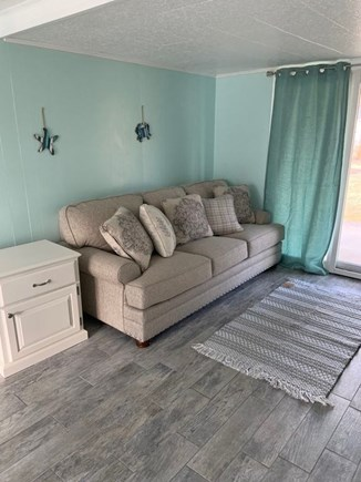 South Yarmouth Cape Cod vacation rental - Additional living space with sliding doors to a covered patio