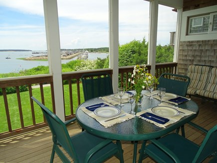 Wellfleet Cape Cod vacation rental - Our favorite space, dine on the porch, vast water views