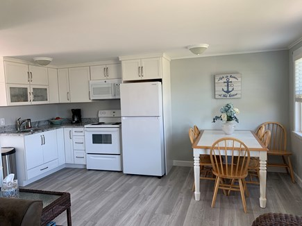 West Dennis Cape Cod vacation rental - Kitchen- NEW floors, cabinets, fridge, stove & microwave
