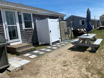 West Dennis Cape Cod vacation rental - Backyard- grill, picnic table & NEW vinyl outdoor shower