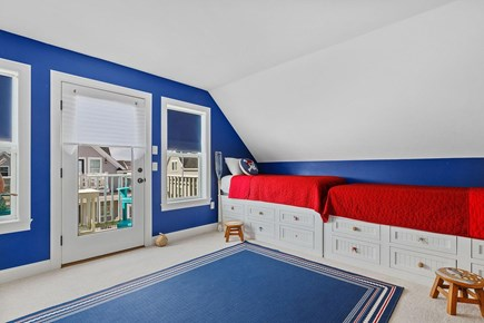 Dennis Cape Cod vacation rental - 4 Single beds + mounted flat screen TV and access to balcony