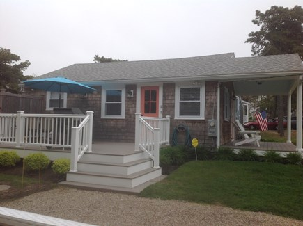 Chatham Cape Cod vacation rental - Deck with Weber grill on left side of cottage next to driveway