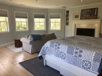 Woods Hole Cape Cod vacation rental - Master Bedroom with King Bed and Fireplace surrounded by woods