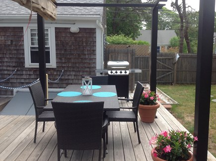 Yarmouth Cape Cod vacation rental - Dining under the pergola, gas grill, and outdoor shower