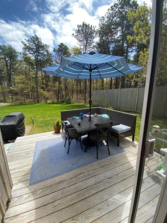 Harwich Cape Cod vacation rental - Deck with seating and table in quiet private backyard