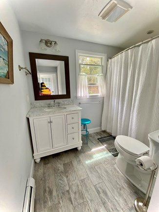 Harwich Cape Cod vacation rental - Downstairs full bath with tub Is light and airy