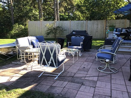 Harwich Cape Cod vacation rental - Patio with seating has lots of twittering birds for ambient sound