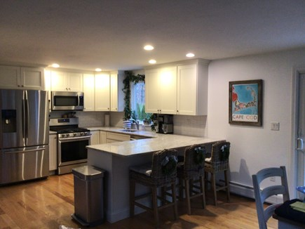 Harwich Cape Cod vacation rental - Kitchen all stainless with granite counters and counter seating