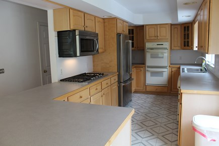 Chatham Cape Cod vacation rental - Open kitchen with 6 burner gas cooktop and double ovens.