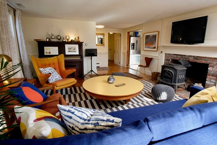 Orleans Cape Cod vacation rental - Welcoming and bright living room with work desk, piano, TV
