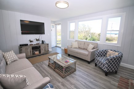 Eastham Cape Cod vacation rental - Bright living room with comfortable furniture, TV and bay views
