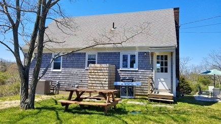 Eastham Cape Cod vacation rental - Backyard with gas grill, enclosed outdoor shower and picnic table