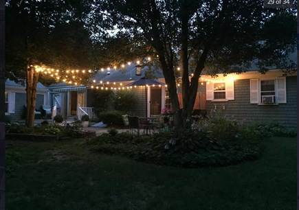 Centerville Cape Cod vacation rental - Our backyard at night- ideal for a long alfresco dinner.