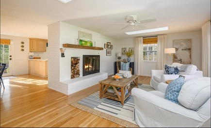 Centerville Cape Cod vacation rental - Open and airy sitting room with working fireplace.
