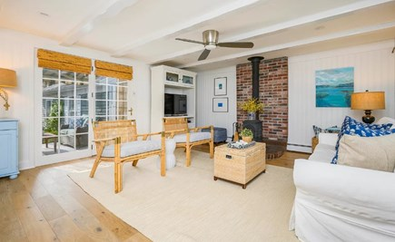 Centerville Cape Cod vacation rental - Inviting living room w/ TV & wood stove flows into the kitchen.