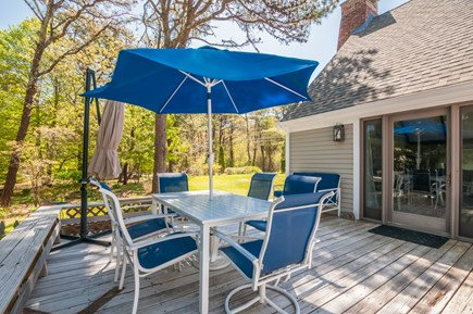 East Sandwich Cape Cod vacation rental - Deck with table, chaise lounges & outdoor shower.