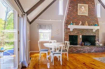 East Sandwich Cape Cod vacation rental - Separate Dining table overlooks back deck and yard.