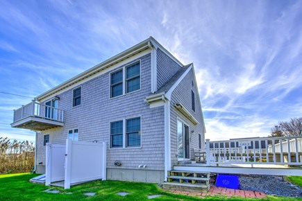 Sandwich Cape Cod vacation rental - Upper level deck on back of house offers water views.
